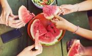 People sharing watermelon