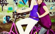 Two girls having fun on a bike