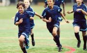 Teens playing football together