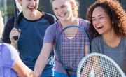 Teens laughing playing tennis