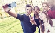 Teenagers taking a selfie