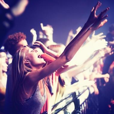 Crowd cheering at a gig