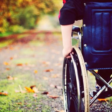 Wheelchair heading down outdoor path