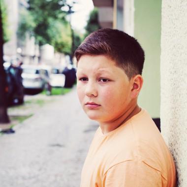 Boy looking down the street