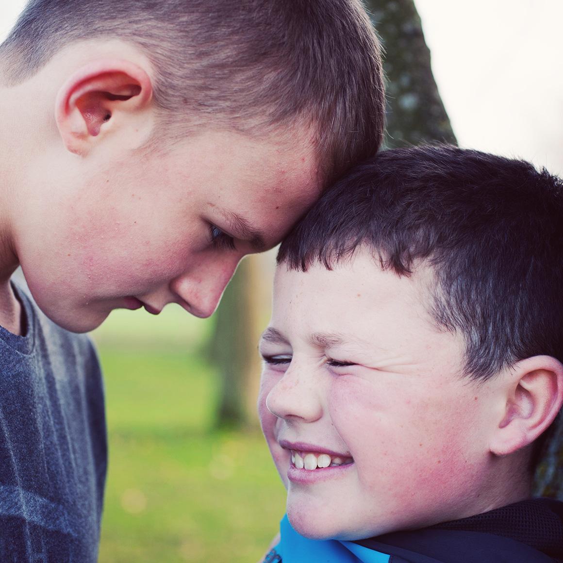 Bully picking on smaller boy