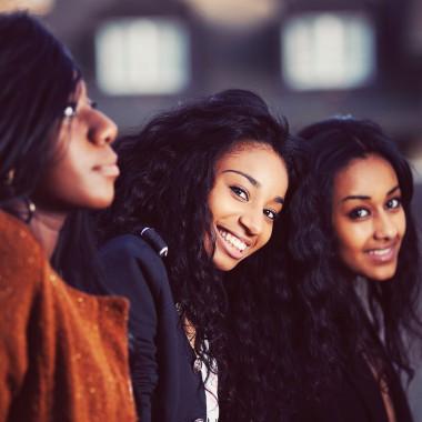 Group of three smiling girls