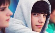 Boy in grey hoodie