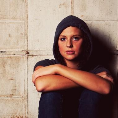 Girl in hoodie looking at camera