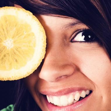 Girl with lemon covering her eye