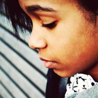 Girl looking sad close up