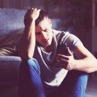 Teen checking his phone