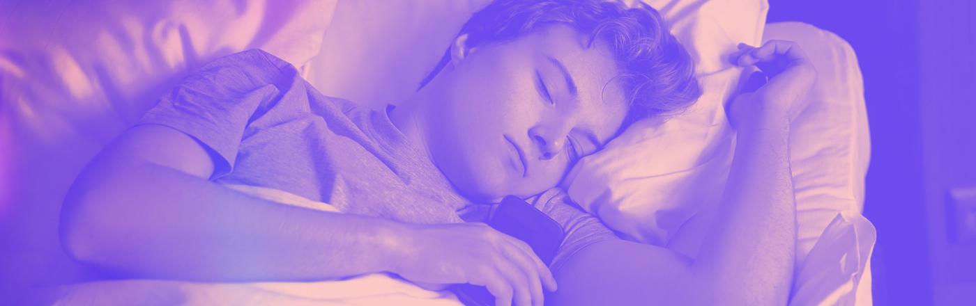 Teen asleep with phone